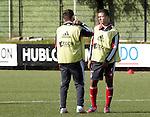 Nederland, Amsterdam, 19 oktober  2012.Seizoen 2012-2013.Training Ajax.Miralem Sulejmani in gesprek met Lorenzo Ebecilio van Ajax in actie met de bal op de training bij jong Ajax