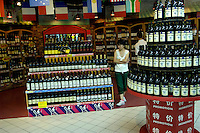 Chinese and Western wines are on sale in a Carrefour supermarket in Beijing, China. Major international chains like Carrefour and Walmart Stores have expanded aggressively in China. Local Chinese retailers have loudly protested this and lobbied heavily for protection from the new competition in price and service that these major retailers have set off..23 Jul 2006
