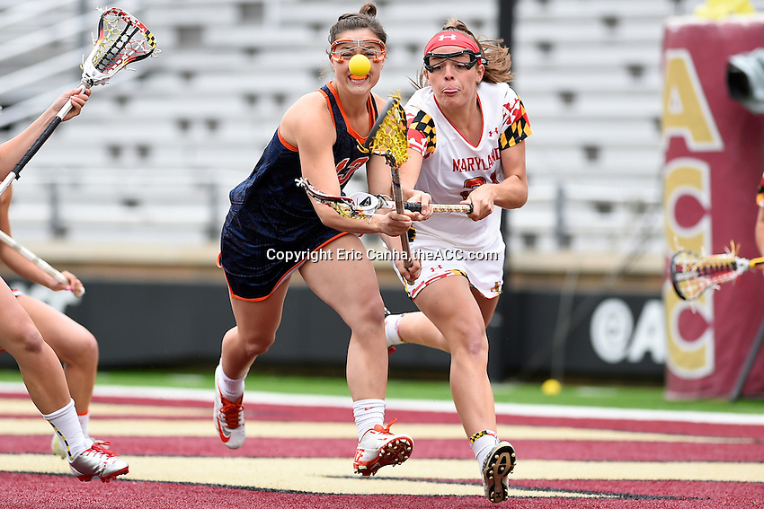Maryland's Taylor Cummings (21) and Syracuse's Mallory Vehar (13) battle for the ball during the 2014 ACC Women's Lacrosse Championship in Boston, MA, Sunday, April 27, 2014. (Photo by Eric Canha,<br /> theACC.com)