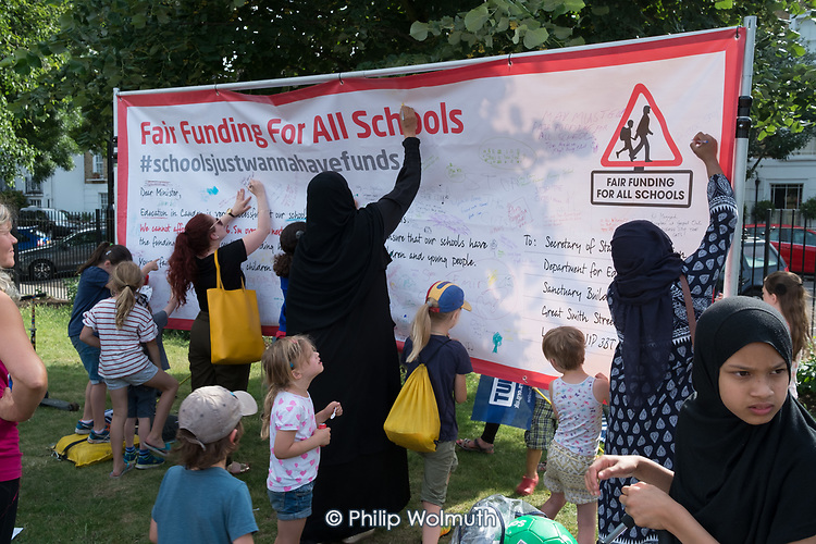 Fair Funding for All Schools.  Pupils, parents and teachers at a Camden NUT rally to oppose cuts to school funding, Kentish Town, London.