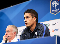 Raphael Varane (Real Madrid) of France & French Head Coach Didier Deschamps during French Press Conference at Clairefontaine-en-Yvelines, Paris, France  on 12 June 2017 ahead of France's friendly International game against England on 13 June 2017. Photo by David Horn/PRiME Media Images.
