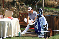 Wenchong Liang (CHN) icing a sore ankle on the 1st during Round 4 of the Hero Indian Open at the DLF Golf and Country Club on Sunday 11th March 2018.<br /> Picture:  Thos Caffrey / www.golffile.ie<br /> <br /> All photo usage must carry mandatory copyright credit (&copy; Golffile | Thos Caffrey)