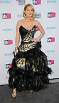 HOLLYWOOD, CA - JANUARY 12: Carrie Keagan arrives at the 17th Annual Critics' Choice Movie Awards at Hollywood Palladium on January 12, 2012 in Hollywood, California.