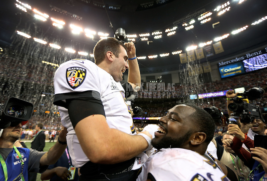 Feb 3, 2013; New Orleans, LA, USA; Baltimore Ravens quarterback Joe Flacco (5) is hoisted by his teammates after defeating the Baltimore Ravens in Super Bowl XLVII at the Mercedes-Benz Superdome. Mandatory Credit: Mark J. Rebilas-