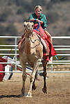 Kristy Federico races at the International Camel Races in Virginia City, Nev., on Friday, Sept. 9, 2011. .Photo by Cathleen Allison