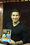 """Bold and the Beautiful Mario Lopez with his new book """"Extra Lean Family"""" - Get Lean and Achieve Your Family's Best Health Ever - at a book signing on May 07, 2011 at Bookends, Ridgewood, New Jersey.  (Photo by Sue Coflin/Max Photos)"""