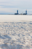 Oil drilling rigs in Alaska's industrial complex of Prudhoe Bay, along Alaska's snow covered arctic north coast.