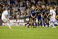 Cristiano Ronaldo of Real Madrid takes a free kick in front of a LA Galaxy wall. Real Madrid beat the LA Galaxy 3-2 in an international friendly match at the Rose Bowl in Pasadena, California on Saturday evening August 7, 2010.