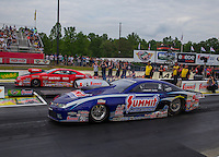 May 15, 2015; Commerce, GA, USA; NHRA pro stock driver Jason Line (near lane) races alongside Erica Enders-Stevens during qualifying for the Southern Nationals at Atlanta Dragway. Mandatory Credit: Mark J. Rebilas-USA TODAY Sports