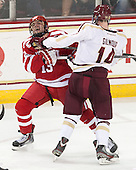 Garrett Noonan (BU - 13), Adam Gilmour (BC - 14) - The Boston College Eagles defeated the visiting Boston University Terriers 6-4 (EN) on Friday, January 17, 2014, at Kelley Rink in Conte Forum in Chestnut Hill, Massachusetts.