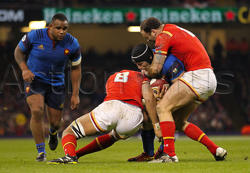 26.02.2016. Principality Stadium, Cardiff, Wales. RBS Six Nations Championships. Wales versus France. France's Wenceslas Lauret gets tackled by Wales Taulupe Faletau and Jamie Roberts