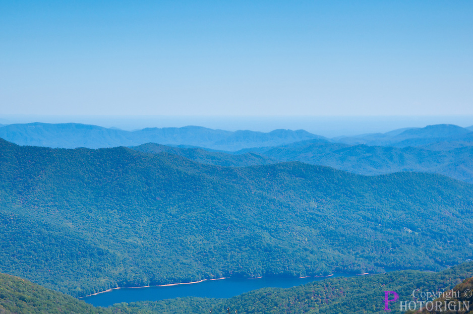 A beautiful view of blue ridge parkway mountain in north carolina, the river water and fog adds color to the picture.