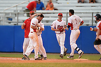 Illinois State Redbirds Sean Beesley (29) is mobbed by teammates after a walk off hit during a game against the Bowling Green Falcons on March 11, 2015 at Chain of Lakes Stadium in Winter Haven, Florida.  Illinois State defeated Bowling Green 8-7.  (Mike Janes/Four Seam Images)