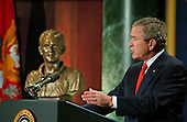Washington, D.C. - February 9, 2006 -- United States President George W. Bush makes remarks on the Global War on Terror at the National Guard Memorial Building in Washington, D.C. on February 9, 2006.  A commemorative bust of First Lieutenant George W. Bush, Texas Air National Guard seems to look on from the left.<br /> Credit: Ron Sachs / CNP