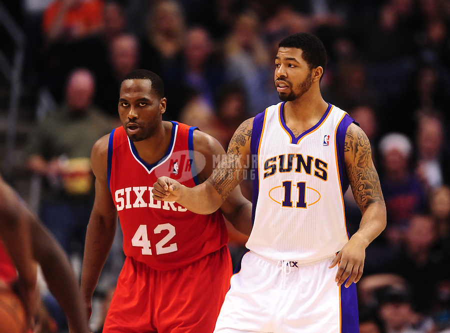 Dec. 28, 2011; Phoenix, AZ, USA; Phoenix Suns forward Markieff Morris (11) and Philadelphia 76ers forward Elton Brand (42) at the US Airways Center. The 76ers defeated the Suns 103-83. Mandatory Credit: Mark J. Rebilas-USA TODAY Sports