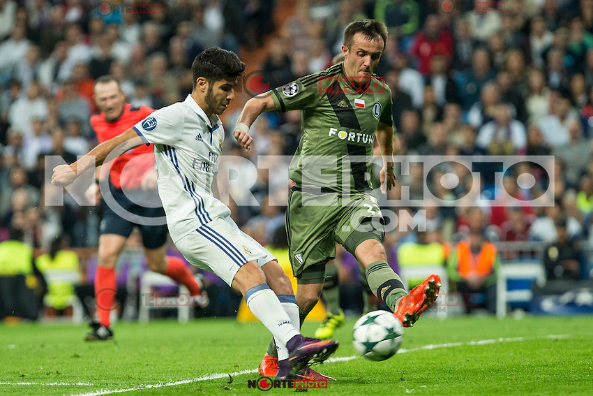 Real Madrid's Marco Asensio Legia Warszawa's Miroslav Radovic  during the match of UEFA Champions League group stage between Real Madrid and Legia de Varsovia at Santiago Bernabeu Stadium in Madrid, Spain. October 18, 2016. (ALTERPHOTOS/Rodrigo Jimenez) /NORTEPHOTO.COM