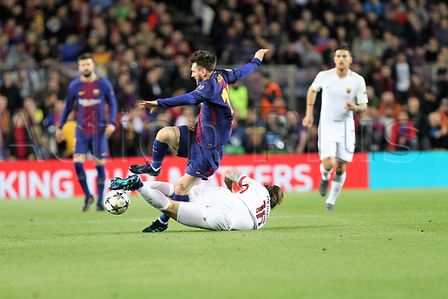 4th April 2018, Camp Nou, Barcelona, Spain; UEFA Champions League football, quarter final 1st leg, Barcelona versus AS Roma; Lionel Messi (Barca) tackled by Daniele De ROSSI (AS Roma)