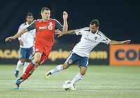 07 March 2012: LA Galaxy midfielder Juninho #19 and Toronto FC forward Danny Koevermans #14 in action during a CONCACAF Champions League game between the LA Galaxy and Toronto FC at the Rogers Centre in Toronto..The game ended in a 2-2 draw.