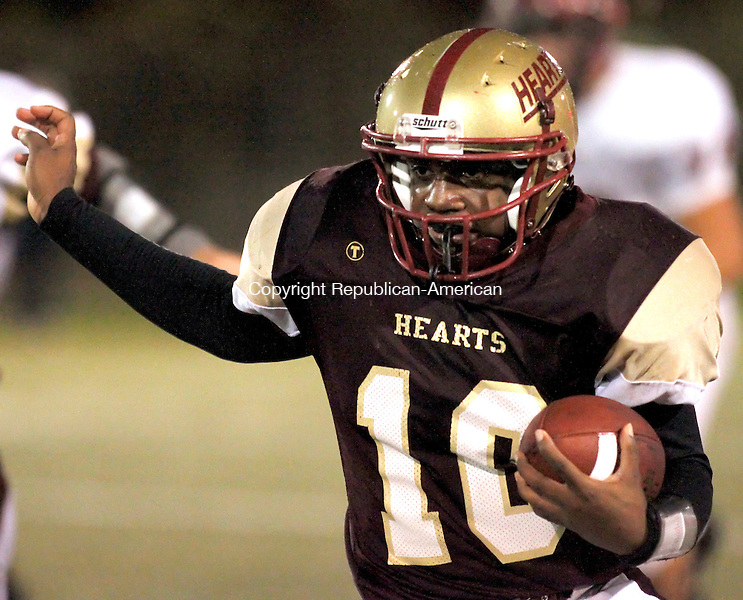Waterbury, CT- 04, November 2010-110410CM12 Sacred Heart's Quarterback Rohan Ifill carries the ball during the Heart's 42-27 win over Torrington Thursday night at Municipal Stadium in Waterbury. Christopher Massa Republican-American