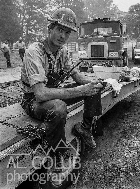 September 3, 1987 Buck Meadows, California – Stanislaus Complex Fire --  US Forest Service dozer boss reads his assignments before leaving fire camp.  The Stanislaus Complex Fire consumed 28 structures and 145,980 acres.  One US Forest Service firefighter, David Ross Erickson, died from a tree-felling accident.