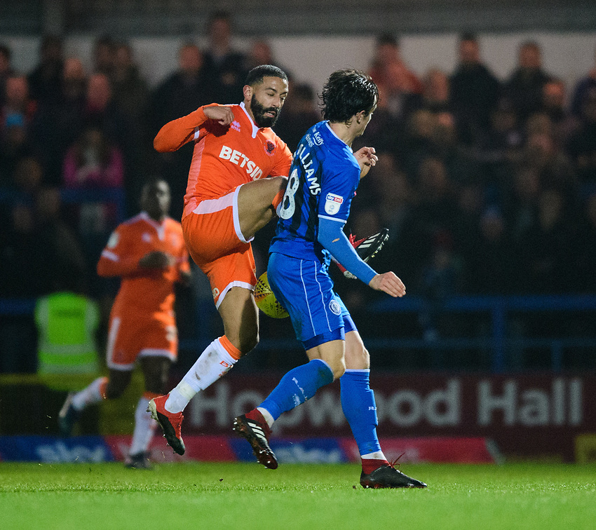 Blackpool's Liam Feeney vies for possession with Rochdale's Jordan Williams<br /> <br /> Photographer Chris Vaughan/CameraSport<br /> <br /> The EFL Sky Bet League One - Rochdale v Blackpool - Wednesday 26th December 2018 - Spotland Stadium - Rochdale<br /> <br /> World Copyright © 2018 CameraSport. All rights reserved. 43 Linden Ave. Countesthorpe. Leicester. England. LE8 5PG - Tel: +44 (0) 116 277 4147 - admin@camerasport.com - www.camerasport.com