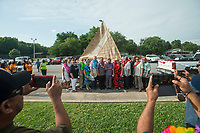 NWA Democrat-Gazette/BEN GOFF @NWABENGOFF<br /> People involved with building the KorKor pose for photos with the finished canoe Friday, May 25, 2018, during the opening ceremony for the 39th annual Republic of the Marshall Islands Jemenei (Constitution) Day celebration at the Jones Center in Springdale. The celebration continues Saturday with basketball, baseball and other sporting events.