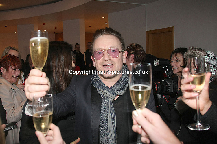 NON EXCLUSIVE PICTURE: MATRIXPICTURES.CO.UK<br /> PLEASE CREDIT ALL USES<br /> <br /> WORLD RIGHTS EXCEPT IRELAND<br /> <br /> Irish U2 frontman Bono is pictured at the St. Stephen's Day Luncheon at Leopardstown Races, Co. Dublin, Ireland, with his wife Ali Hewson.<br /> <br /> Bono and Ali bought two bottles of Bollinger Champagne and had a Christmas drink with Irish media.<br /> <br /> DECEMBER 26th 2013<br /> <br /> REF: MDE 138087