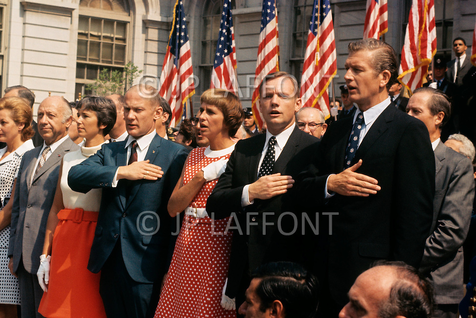 14 Aug 1969, Manhattan, New York City, New York State, USA --- L-R: Astronauts Michael Collins, Neil Armstrong and Buzz Aldrin with their medals alongside the Mayor of NYC, J. Lindsay and Thomas Paine, NASA administrator, after a parade that started from Grand Central Station. August 14, 1969 --- Image by © JP Laffont