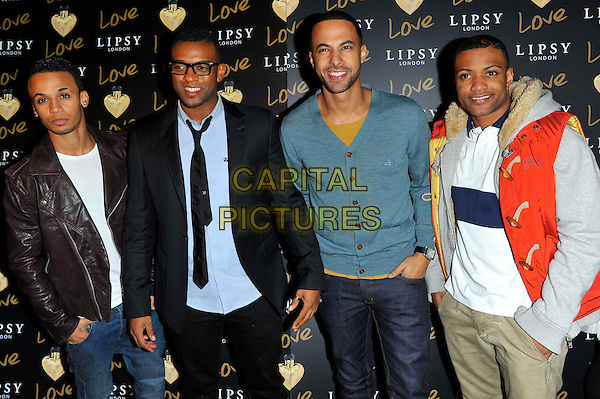"JLS - Aston Merrygold, Oritse Williams, Marvin Humes & Jonathan ""JB"" Gill.The Lipsy London Love launch party at Gilgamesh. London, England..November 6th, 2012.half length brown black blue teal red leather suit jacket shirt tie glasses cardigan band group.CAP/CJ.©Chris Joseph/Capital Pictures."