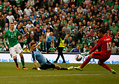 June 4th 2017, Aviva Stadium, Dublin, Ireland; International football friendly, Republic of Ireland versus Uruguay; James McClean fires past Esteban Conde to give Republic of Ireland a 3-1 lead in the 77th minute