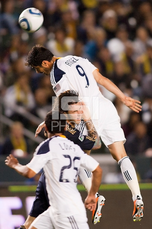 LA Galaxy forward Juan Pablo Angel (9) goes high over Danny Califf (4) of Phily for a headball. The LA Galaxy defeated the Philadelphia Union 1-0 at Home Depot Center stadium in Carson, California on  April  2, 2011....
