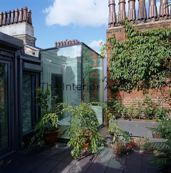 The bath is built into a glass box that extends on to the roof terrace and is a great place for cloud watching and star gazing