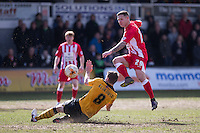 Billy Kee of Accrington Stanley sees his shot blocked by Yan Klukowski of Newport County during the Sky Bet League 2 match between Newport County and Accrington Stanley at Rodney Parade, Newport, Wales on 28 March 2016. Photo by Mark  Hawkins.