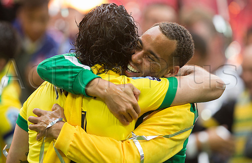 25.05.2015.  London, England. Skybet Championship Playoff Final. Middlesborough versus Norwich. Norwich City's Elliott Bennett hugs Bradley Johnson at the final whistle.