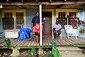 Kellie Dominick, who graduated from Marksville High school in 2016 and Mable Johnson hang out on their porch in Marksville, La., Sept. 17, 2017.