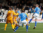 Jamie Adams heads in the opening goal for St Johnstone as it is deflected over the line by Tim Clancy on its way in