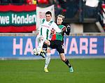 Nederland, Nijmegen, 27 januari 2013.Eredivisie.Seizoen 2012-2013.N.E.C.-FC Groningen .Andraz Kirm van FC Groningen en Nathaniel Will van N.E.C. strijden om de bal.