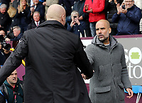 Manchester City manager Josep Guardiola (right) is greeted by Burnley manager Sean Dyche ahead of kick-off<br /> <br /> Photographer Rich Linley/CameraSport<br /> <br /> The Premier League - Burnley v Manchester City - Sunday 28th April 2019 - Turf Moor - Burnley<br /> <br /> World Copyright © 2019 CameraSport. All rights reserved. 43 Linden Ave. Countesthorpe. Leicester. England. LE8 5PG - Tel: +44 (0) 116 277 4147 - admin@camerasport.com - www.camerasport.com