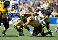 September 4, 2010:  Mike Mohamed of California wraps around Jonathan Franklin of UCLA for a loss during a game at Memorial Stadium in Berkeley, California.   California defeated UCLA 35-7