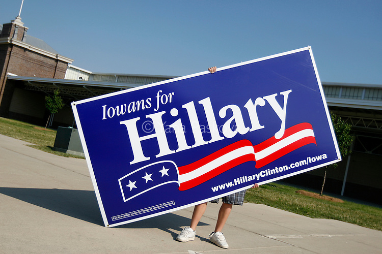 A man carries an enormous sign for Democratic Presidential hopeful Hillary Clinton (D-NY). The former first lady brought along her husband, former President Bill Clinton, as she campaigned at the Iowa State Fairgrounds in Des Moines, Iowa, on July 2, 2007.