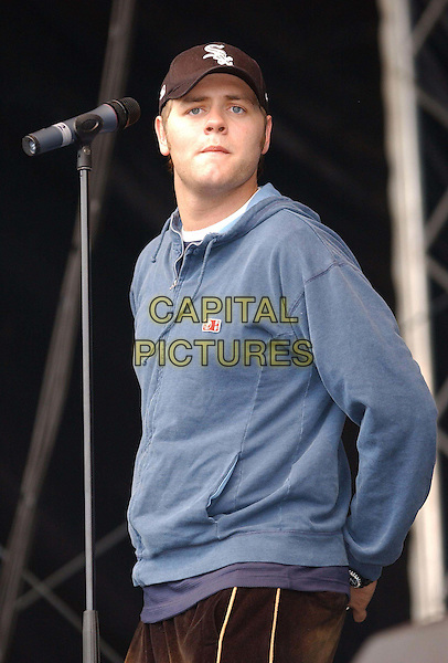 WESTLIFE - Brian MCFADDEN<br /> 96.4 BRBM's Party in the Park <br /> sales@capitalpictures.com<br /> www.capitalpictures.com<br /> &copy;Capital Pictures<br /> music, live, concert, stage, blue hooded top, baseball cap