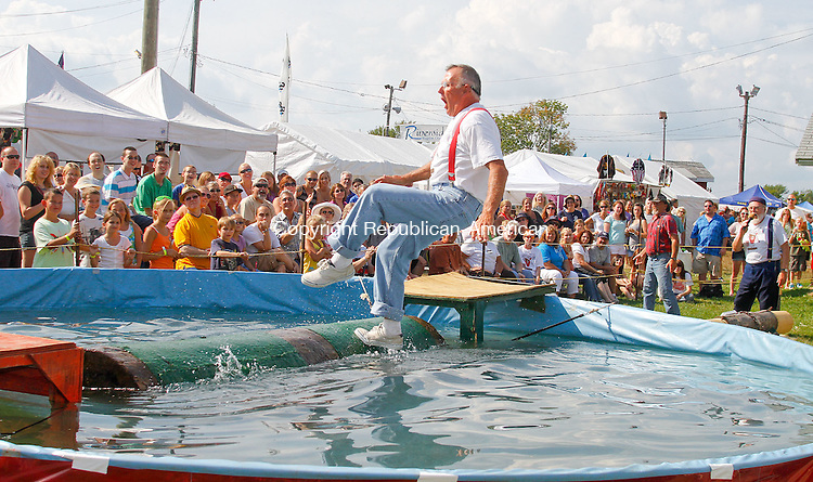 PLYMOUTH, CT- 25 AUGUST 2012 082512JW09- The Indian River Olde Time Lumberjack show member Bob Bosco loses his concentration and his balance  during a log roll Saturday afternoon at the Terryville Fair..Jonathan Wilcox Republican American..