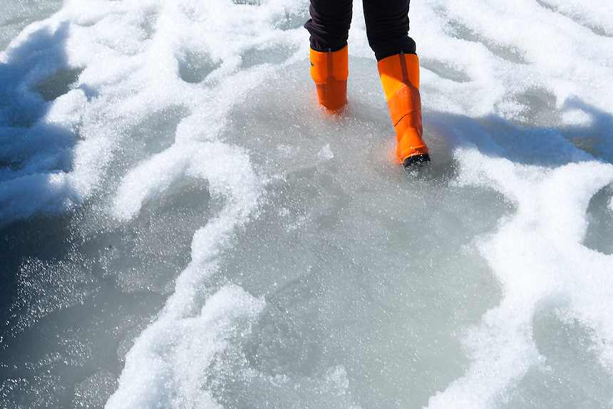 The melting snow on the surface is a clear indicator that summer melting has begun.