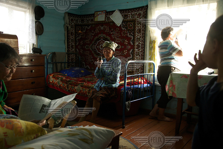 Female members of the Natpiool family take a rest in their house set in the taiga in Chodura village Tuva Republic, Russia.  Like many other animal herders in the republic, they prefers traditional farming methods but finds it difficult to compete in modern society.