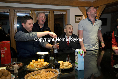 """Wassailers travel around the village of Curry Rivel Somerset on old New Years Eve, January 5th, singing a traditional wassailing song, and bidding the house holders """"... and a happy New Year"""", before being invited in for refreshment.  UK.  2016"""