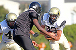 Beverly Hills, CA 09/23/11 - Rory Hubbard (Peninsula #33), Andrew Dizon (Peninsula #40) and unknown Beverly Hills player(s) in action during the Peninsula-Beverly Hills frosh football game at Beverly Hills High School.