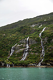 USA, Alaska, Seward, waterfalls spotted near Holgate Glacier seen while exploring Resurrection Bay