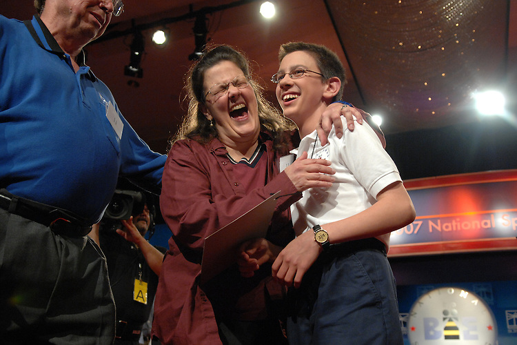 "Evan M. O'Dorney, 13, of Danville, Cailf., gets a hug from his mother Jennifer as his father Michael, looks on, after Evan won the 2007 Scripps National Spelling Bee with on the word ""serrefine,"" Thursday night at the Grand Hyatt."