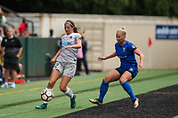 Seattle, WA - Sunday, August 13, 2017: Ashley Hatch, Merritt Mathias during a regular season National Women's Soccer League (NWSL) match between the Seattle Reign FC and the North Carolina Courage at Memorial Stadium.