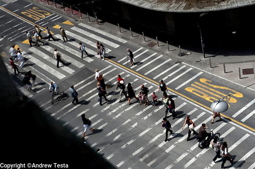 SLOVENIA. Ljubljana . 26th July 2011.<br /> Pedestrians cross the road in downtonwn Ljubljana.<br /> &copy;Andrew Testa for the New York Times